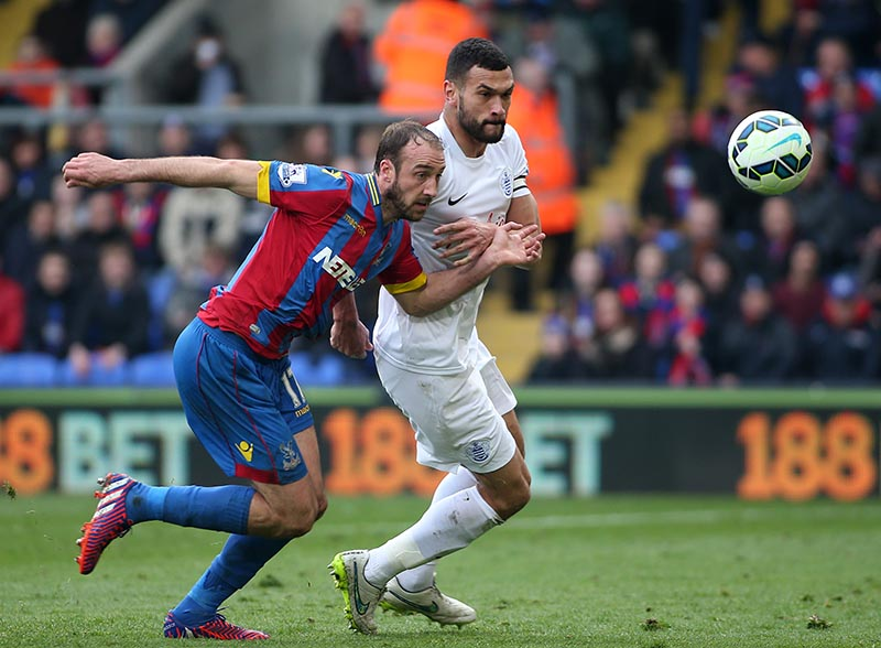 14 March 2015 - Barclays Premier League - Crystal Palace v Queens Park Rangers - Glenn Murray of Palace battles with Steven Caulker of QPR. Photo: Ryan Smyth/Offside