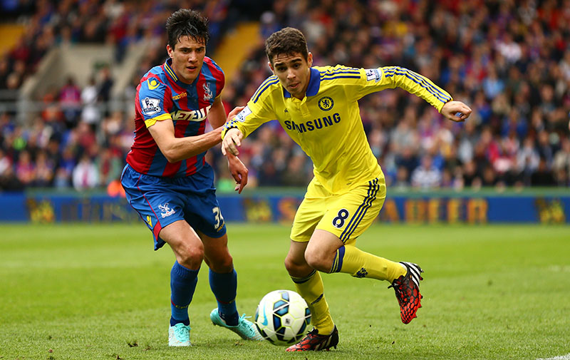 18 October 2014 - Barclays Premier League - Crystal Palace v Chelsea - Oscar of Chelsea in action with Martin Kelly of Crystal Palace - Photo: Marc Atkins / Offside.