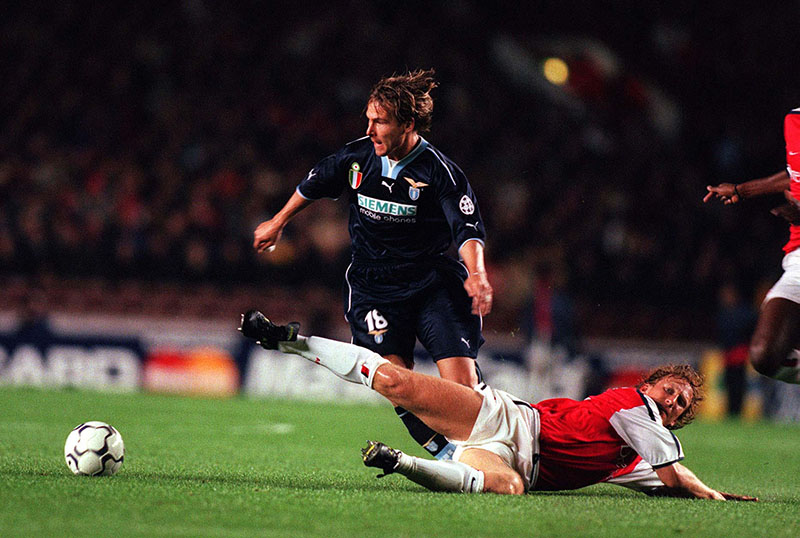 27/9/00 Champions League. Arsenal v Lazio. Ray Parlour is left on the floor by Pavel Nedved. Photo: Mark Leech.