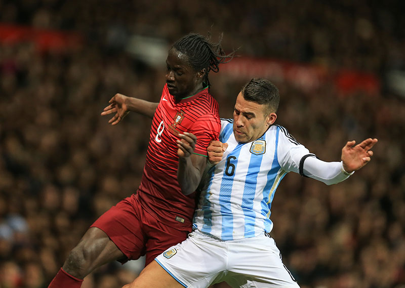 18 November 2014 - International Friendly - Argentina v Portugal - Eder of Portugal tangles with Nicolas Otamendi of Argentina - Photo: Marc Atkins / Offside.