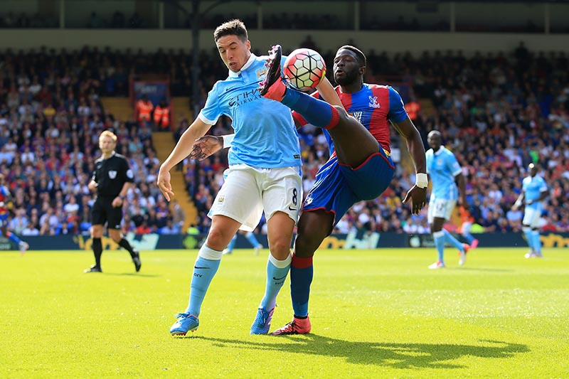 12 September 2015 - Barclays Premier League - Crystal Palace v Manchester City - Samir Nasri of Manchester City tangles with Sako of Crystal Palace - Photo: Marc Atkins / Offside.