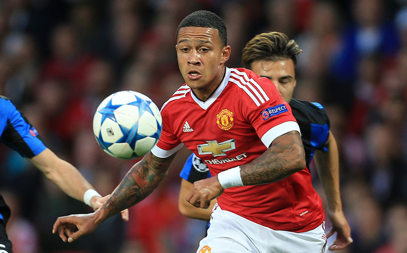 18th August 2015 - UEFA Champions League - Qualifying Play-Off (1st Leg) - Manchester United v Club Brugge - Memphis Depay of Man Utd battles with Tuur Dierckx of Brugge - Photo: Simon Stacpoole / Offside.
