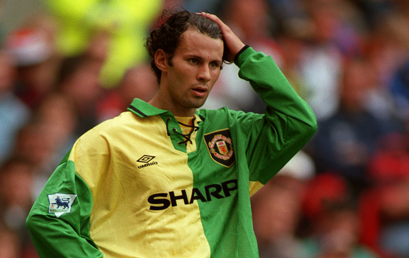 31 July 1993 Friendly football match Manchester United v Benfica - Ryan Giggs wearing the green and yellow United change kit. Photo: Mark Leech.