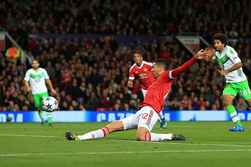 30th September 2015 - UEFA Champions League - Group B - Manchester United v VfL Wolfsburg - Chris Smalling of Man Utd scores their 2nd goal - Photo: Simon Stacpoole / Offside.