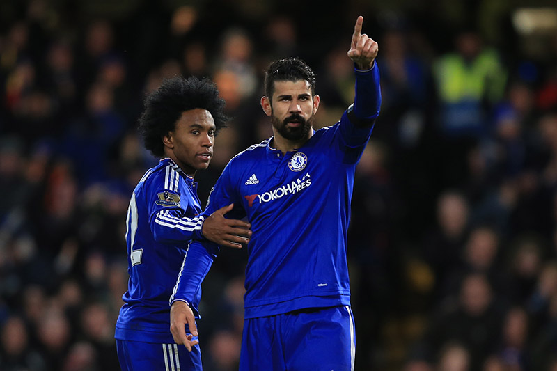 21 November 2015 - Barclays Premier League - Chelsea v Norwich City - Diego Costa of Chelsea celebrates scoring  the first goal with Willian - Photo: Marc Atkins / Offside.