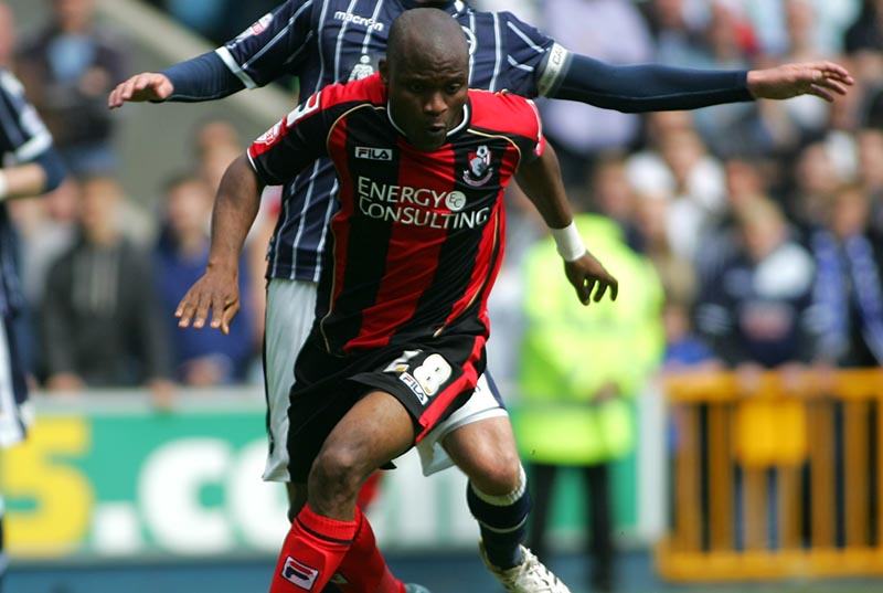 03 May 2014 - Sky Bet Championship - Millwall v AFC Bournemouth - Tokelo Rantie of Bournemouth is put under pressure by Alan Dunne of Millwall. Photo: Ryan Smyth/Offside
