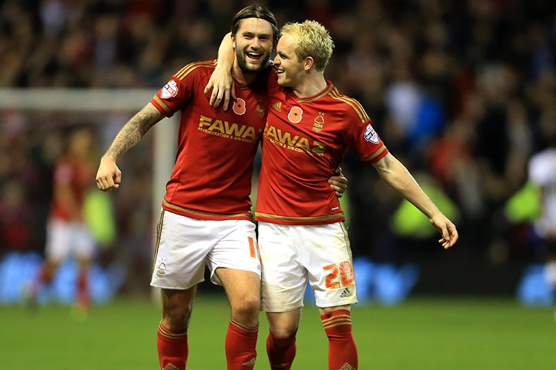 6th November 2015 - Sky Bet Championship - Nottingham Forest v Derby County - Henri Lansbury of Forest (L) and teammate Jonathan Williams celebrate victory - Photo: Simon Stacpoole / Offside.