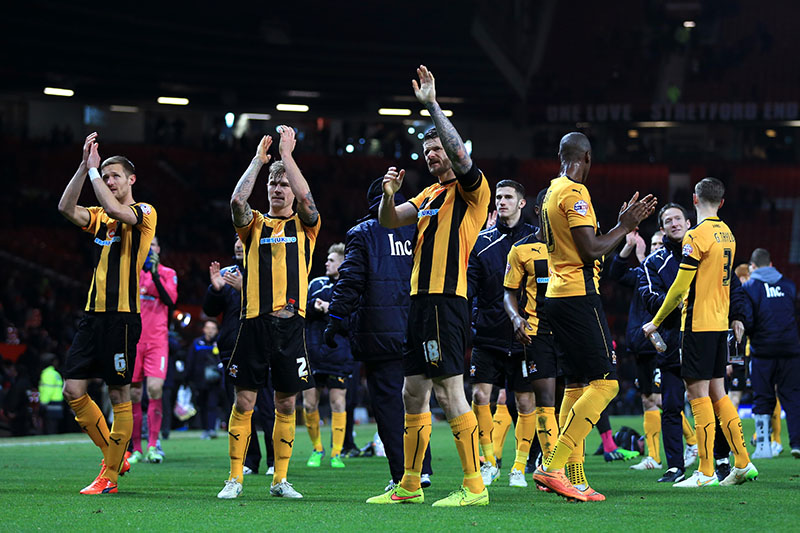 3rd February 2015 - FA Cup - 4th Round Replay - Manchester United v Cambridge United - Michael Nelson of Cambridge (C) and his teammates applaud the travelling support after the match - Photo: Simon Stacpoole / Offside.