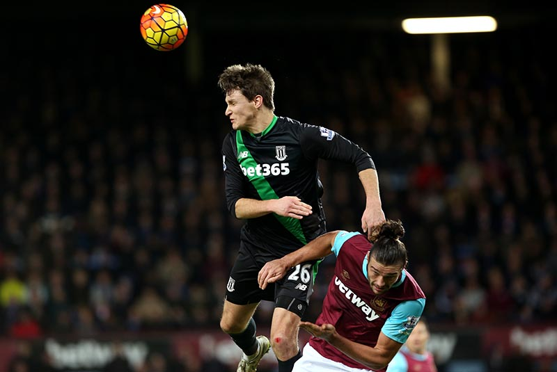 12 December 2015 - Premier League - West Ham United v Stoke City Philipp Wollscheid of Stoke uses Andy Carroll of West Ham as leverage to win a header Photo: Charlotte Wilson / Offside