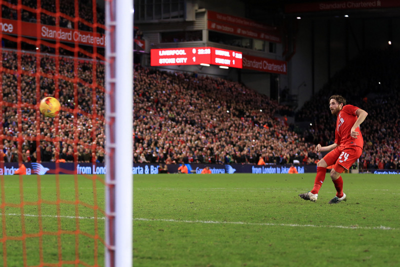 26th January 2016 - Capital One Cup - Semi-Final (2nd Leg) - Liverpool v Stoke City - Joe Allen of Liverpool scores the winning penalty in the shoot-out - Photo: Simon Stacpoole / Offside.
