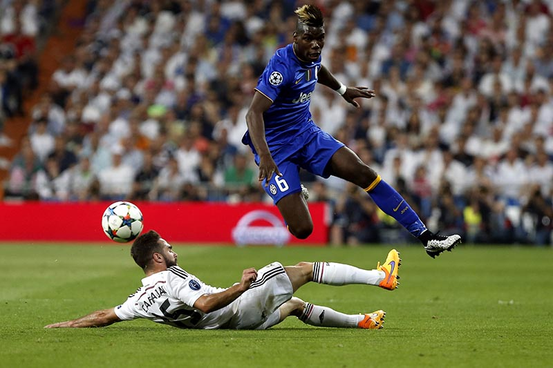 13 May 2015 - Uefa Champions League - Real Madrid v Juventus - Carvajal of Madrid tackles Paul Pogba of Juventus.
