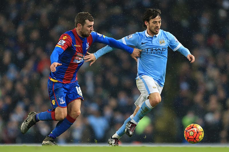 16th January 2016 - Barclays Premier League - Manchester City v Crystal Palace - David Silva of Man City battles with James McArthur of Palace - Photo: Simon Stacpoole / Offside.