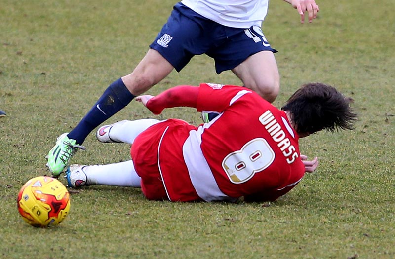14 February 2015 - Sky Bet League Two - Southend United v Accrington Stanley - Josh Windass of Stanley tackles Jack Payne of Southend. Photo: Ryan Smyth/Offside