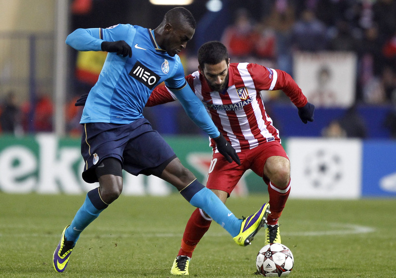 Atletico Madrid v FC Porto Arda Turan is tackled by Jackson Martinez. Photo: Offside / MarcaMedia.