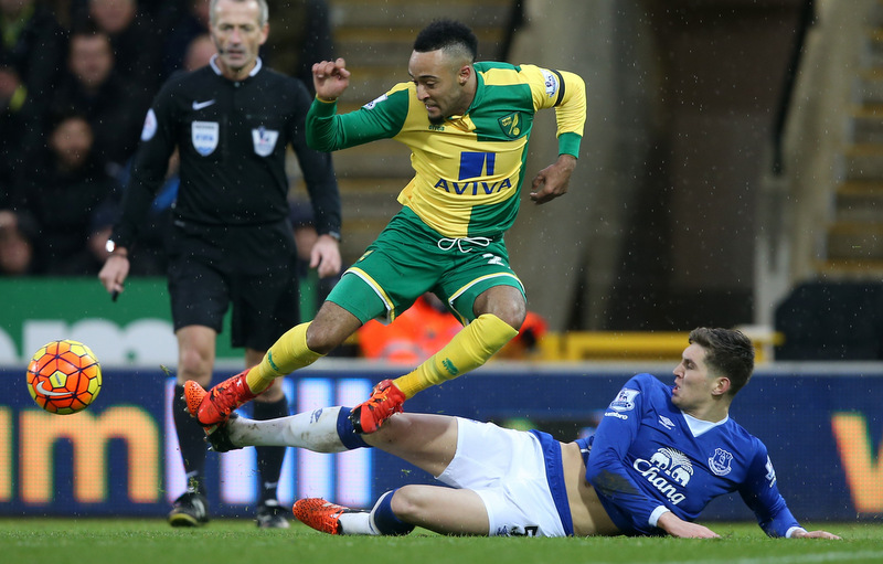 12 December 2015 Premier League Football : Norwich City v Everton : Nathan Redmond of Norwich is tackled by John Stones of Everton.Photo: Mark Leech
