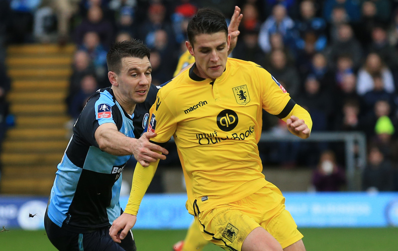 9 January 2016 - The Emirates FA Cup - 3rd Round - Wycombe Wanderers v Aston Villa - Matthew Bloomfield of Wycombe Wanderers tangles with Ashley Westwood of Aston Villa - Photo: Marc Atkins / Offside.