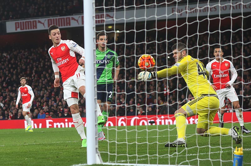 02 February 2016  - Premier League Football - Arsenal v Southampton: Southampton goalkeeper Fraser Forster makes a point blank save from Mesut Ozil. Photo: Mark Leech