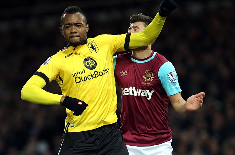 2 February 2016 - Premier League - West Ham United v Aston Villa Jordan Ayew of Villa elbows Aaron Cresswell of West Ham in the face and is subsequently shown a red card Photo: Charlotte Wilson / Offside