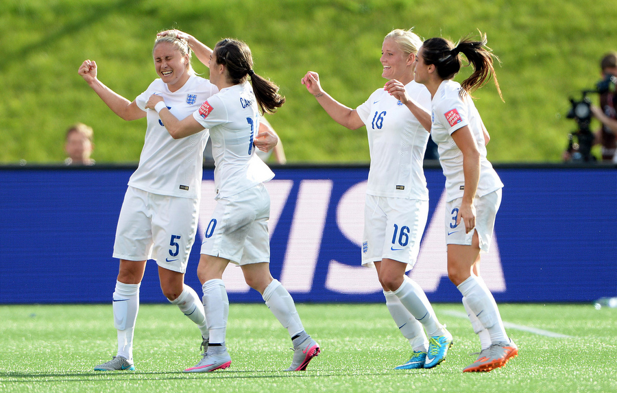 22 June 2015 - FIFA Womens World Cup - Norway v EnglandKaren Carney, Katie Chapman and Claire Rafferty swarm captain Steph Houghton to celebrate her goal for EnglandPhoto: Offside/Witters