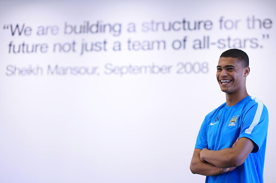 14th April 2015 - Feature - Manchester City Academy - Academy player Cameron Humphreys-Grant poses for a portrait in front of a quote from club owner Sheikh Mansour - Photo: Simon Stacpoole / Offside.