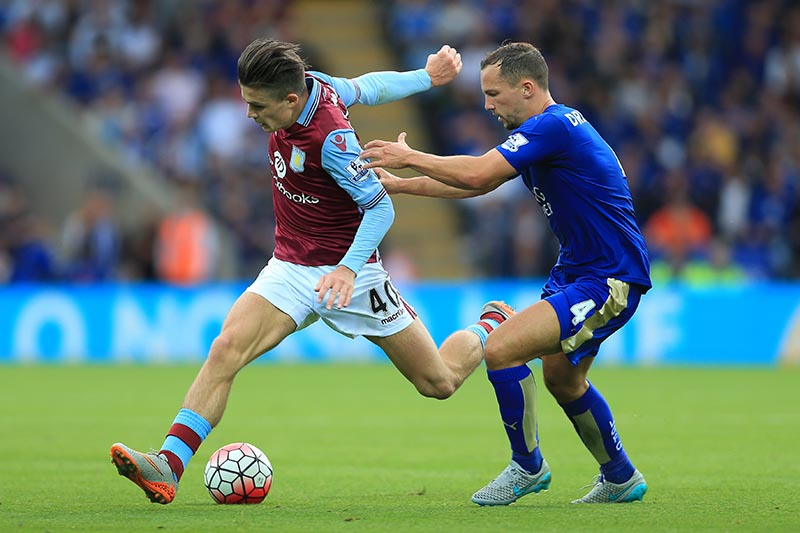 13th September 2015 - Barclays Premier League - Leicester City v Aston Villa - Jack Grealish of Villa battles with Daniel Drinkwater of Leicester - Photo: Simon Stacpoole / Offside.