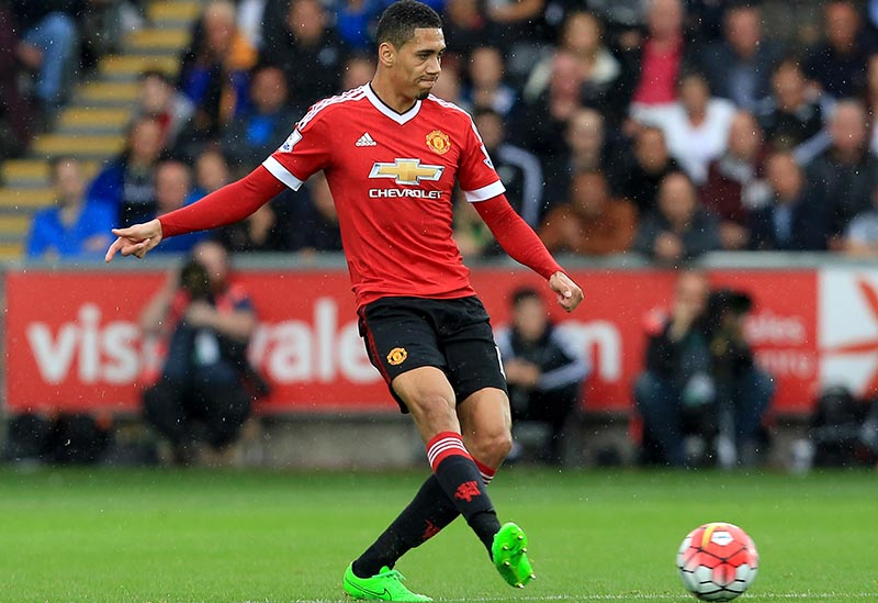 30th August 2015 - Barclays Premier League - Swansea v Manchester United - Chris Smalling of Manchester United - Photo: Paul Roberts / Offside.