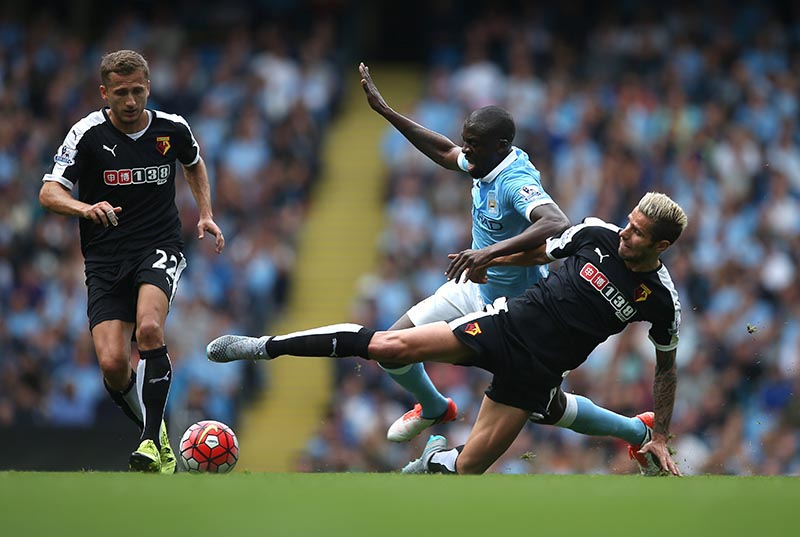 29 August 2015 Premier League Football - Manchester City v Watford;  Yaya Toure of City is tackled by Valon Behrami. Photo: Mark Leech