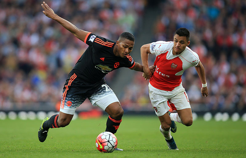 4 October 2015 - Barclays Premier League - Arsenal v Manchester United - Alexis Sanchez of Arsenal in action with Antonio Valencia of Manchester United - Photo: Marc Atkins / Offside.