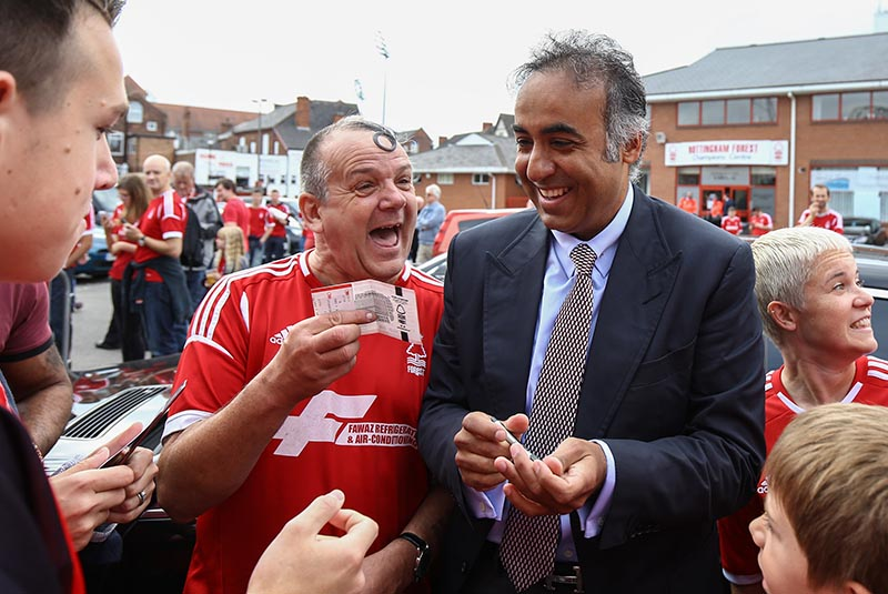 14 September 2014 - Sky Bet Championship  - Nottingham Forest v Derby County - A Forest fan reacts after having his match ticket signed by Nottingham Forest Chairman, Fawaz Al Hasawi - Photo: Marc Atkins / Offside.
