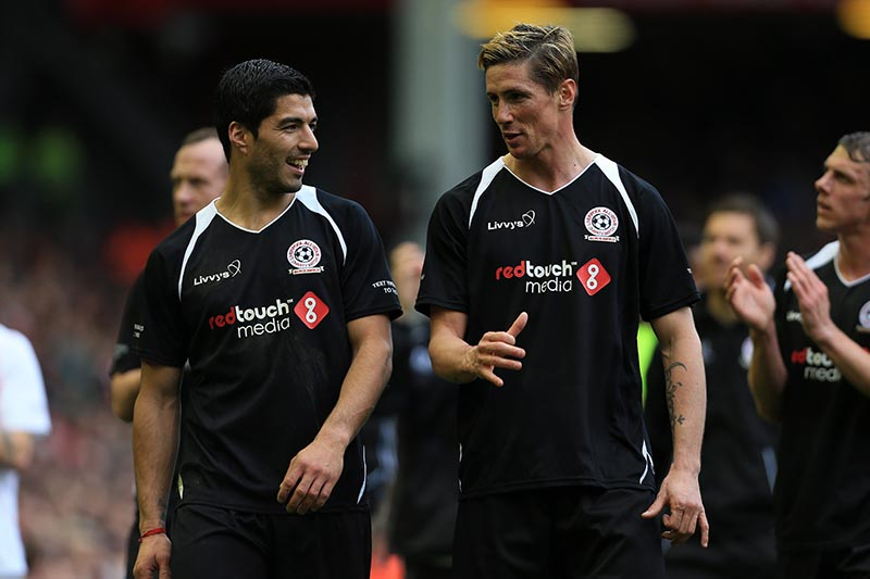 29th March 2015 - Liverpool All-Stars Charity Match - Luis Suarez (L) and Fernando Torres - Photo: Simon Stacpoole / Offside.