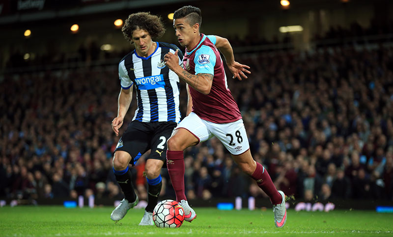 14 September 2015 - Barclays Premier League - West Ham v Newcastle United - Manuel Lanzini of West Ham in action with Fabrizio Coloccini of Newcastle United - Photo: Marc Atkins / Offside.