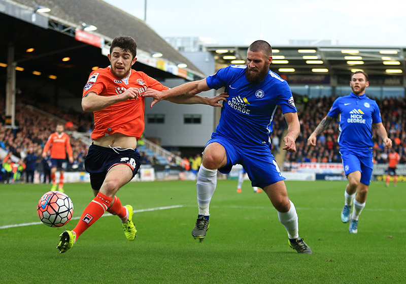6 December 2015 - The FA Cup - (2nd Round) - Peterborough United v Luton Town - Sean Long of Luton Town  tangles with Michael Bostwick of Peterborough United - Photo: Marc Atkins / Offside.