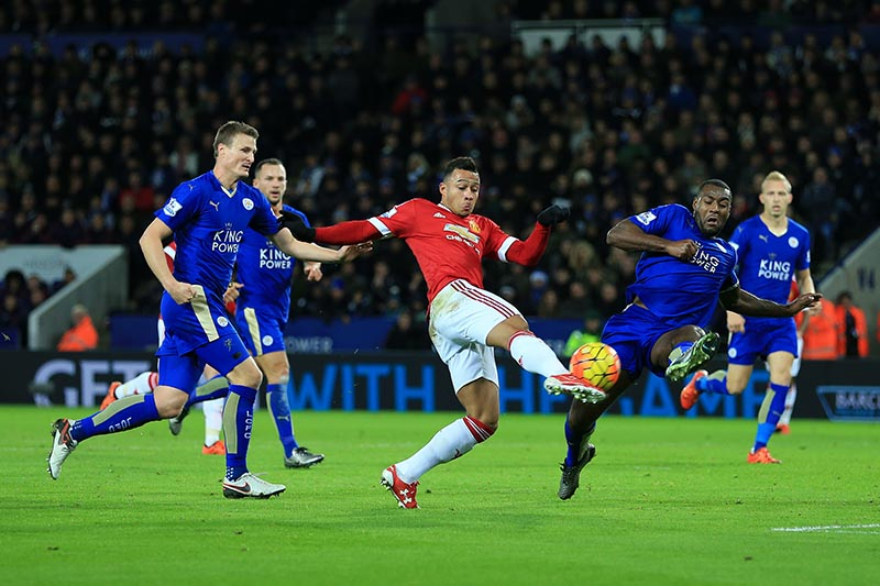 28th November 2015 - Barclays Premier League - Leicester City v Manchester United - Wes Morgan of Leicester blocks a shot from Memphis Depay of Man Utd - Photo: Simon Stacpoole / Offside.