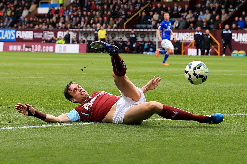 25th April 2015 - Barclays Premier League - Burnley v Leicester City - Michael Duff of Burnley slices the ball towards his own net to help give Leicester a 0-1 lead - Photo: Simon Stacpoole / Offside.