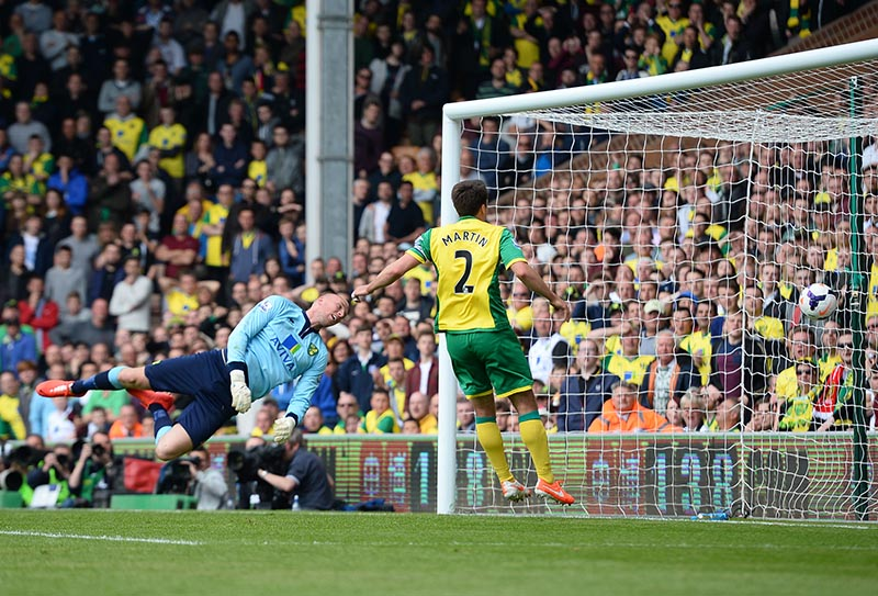 20 April 2014 - Barclays Premier League - Norwich City v Liverpool - John Ruddy of Norwich City looks back as Raheem Sterling's deflected shot off of Bradley Johnson of Norwich City hits the back of the net to make it 1-3 - Photo: Marc Atkins / Offside.