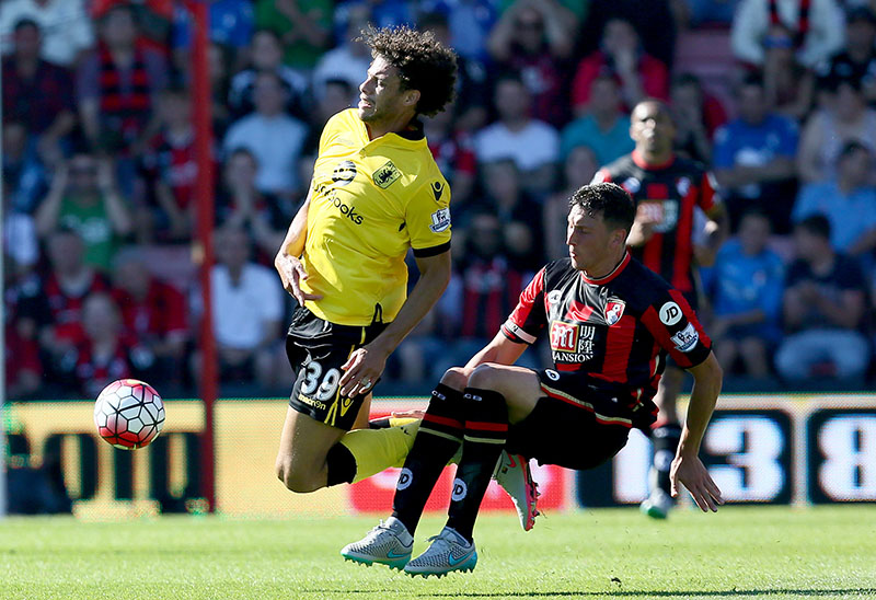 8th August 2015 - Barclays Premier League - AFC Bournemouth v Aston Villa - Rudy Gestede of Aston Villa is fouled by Tommy Elphick of Bournemouth - Photo: Paul Roberts / Offside.