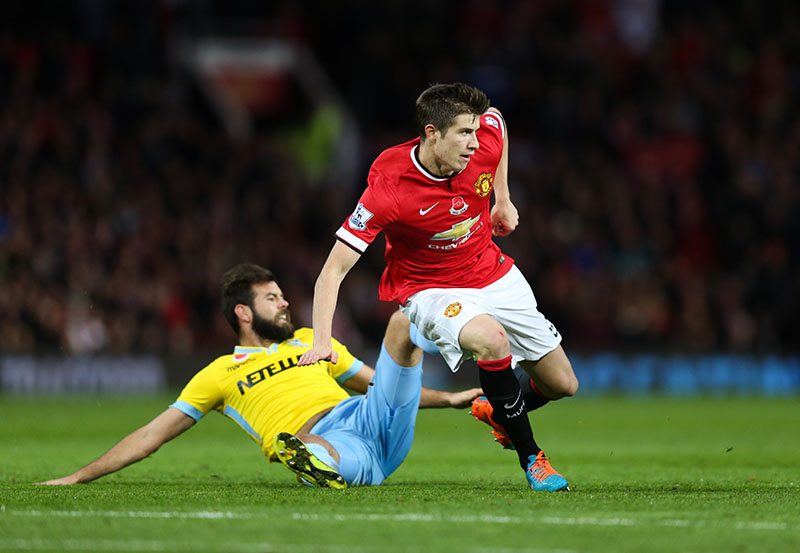 8 November 2014 - Barclays Premier League - Manchester United v Crystal Palace - Paddy McNair of Manchester United tangles with Joe Ledley of Crystal Palace - Photo: Marc Atkins / Offside.