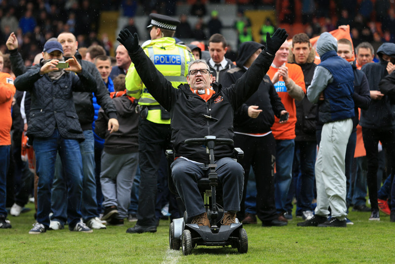 2nd May 2015 - Sky Bet Championship - Blackpool v Huddersfield Town - A disabled fan on a motorised scooter protests on the pitch - Photo: Simon Stacpoole / Offside.