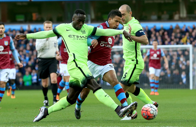 30th January 2015 - Emirates FA Cup 4th Round - Aston Villa v Manchester City - Bacary Sagna of Manchester City stretches to deny Scott Sinclair of Aston Villa - Photo: Paul Roberts / Offside.