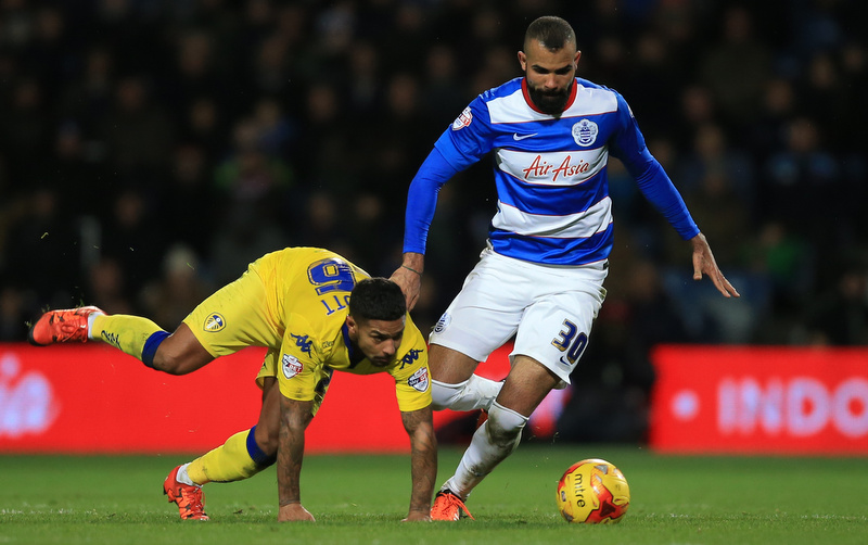 28 November 2015 - Sky Bet Championship - QPR v Leeds United - Liam Cooper of Leeds United in action with Sandro of Queens Park Rangers - Photo: Marc Atkins / Offside.