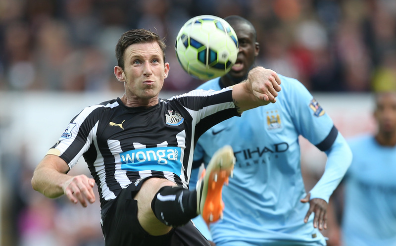 17 August 2014 FA Premier League Football - Newcatle United v Manchester City - United defender Mike Williamson clears the ball.Photo: Mark Leech